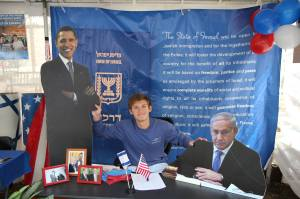 Jake Schwartz, Student, poses with cutouts of President Barrack Obama and the Israeli Prime Minister.