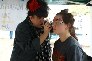 Allyson Holland, student, gets her face paint done.